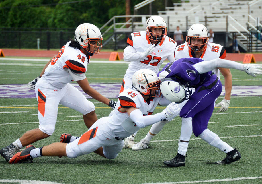 Edwardsville linebacker Ryan Connelly (No. 33) and the defense swarm a Collinsville ball carrier during last year's regular season.