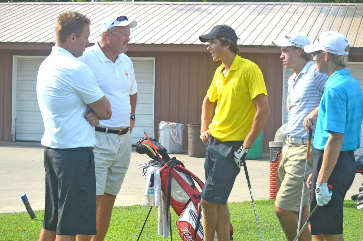 Adam Tyler, left, and Doug Wright, who are the new co-head coaches for the Edwardsville boys' golf team, talk with EHS golfers (from left) Kyle Hylla, Jon Ratterman and Colin Loyet on Wednesday during the team's first practice at Oak Brook Golf Club.