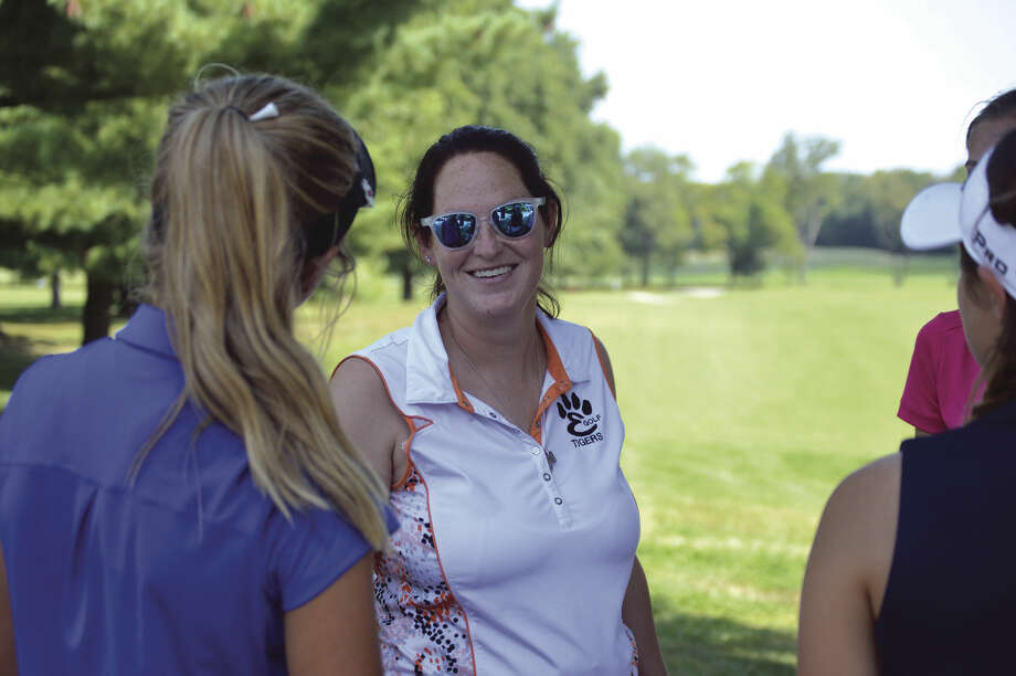 Edwardsville girls' golf coach Abby Comerford talks to her team after a nine-hole round at Oak Brook Golf Club on Thursday.