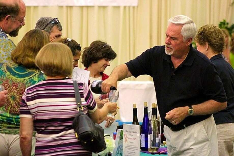 Guests sample wine at a previous Midwest Wine and Beer Festival.