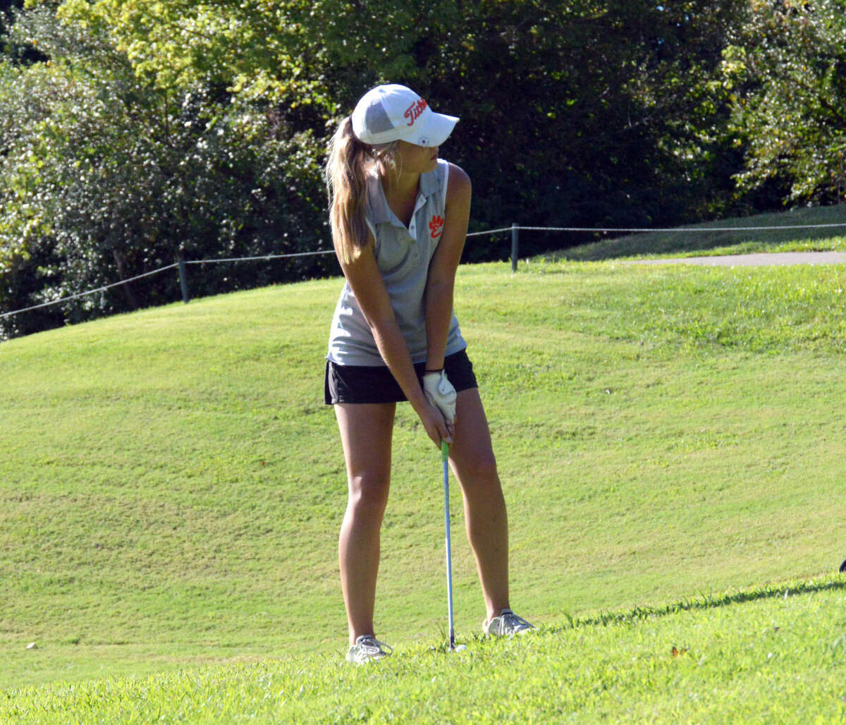 Edwardsville junior Addy Zeller lines up her chip shot on the ninth hole at the Woodlands Golf Club in Alton.