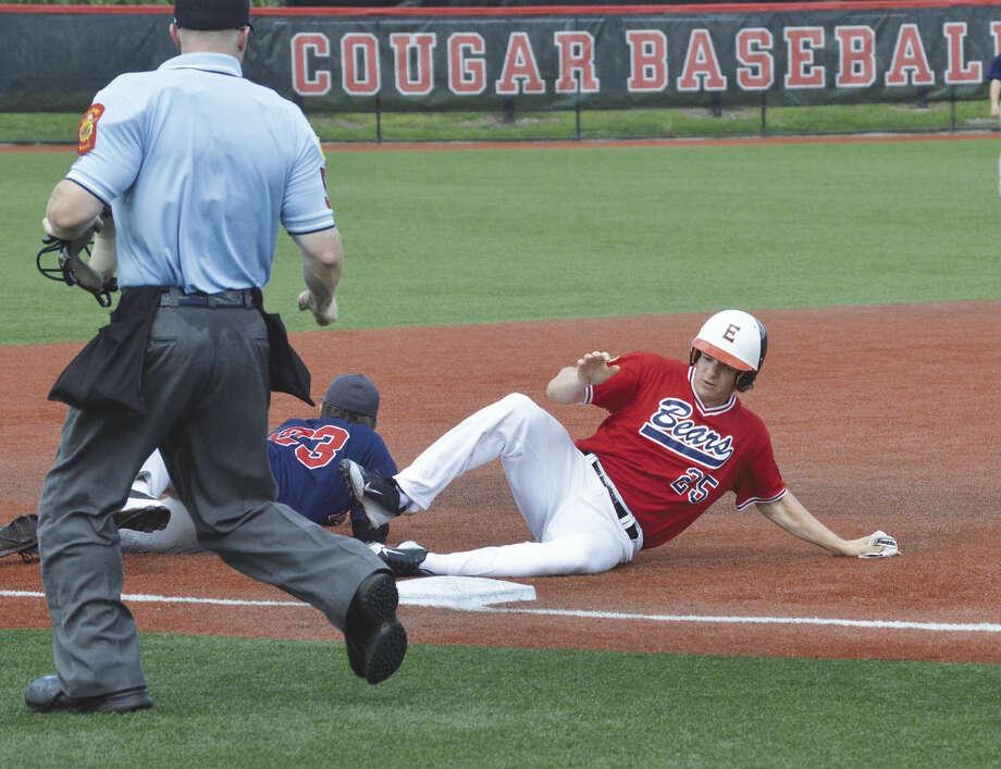 Bears designated hitter Tyler Stamer slides safely into third base.