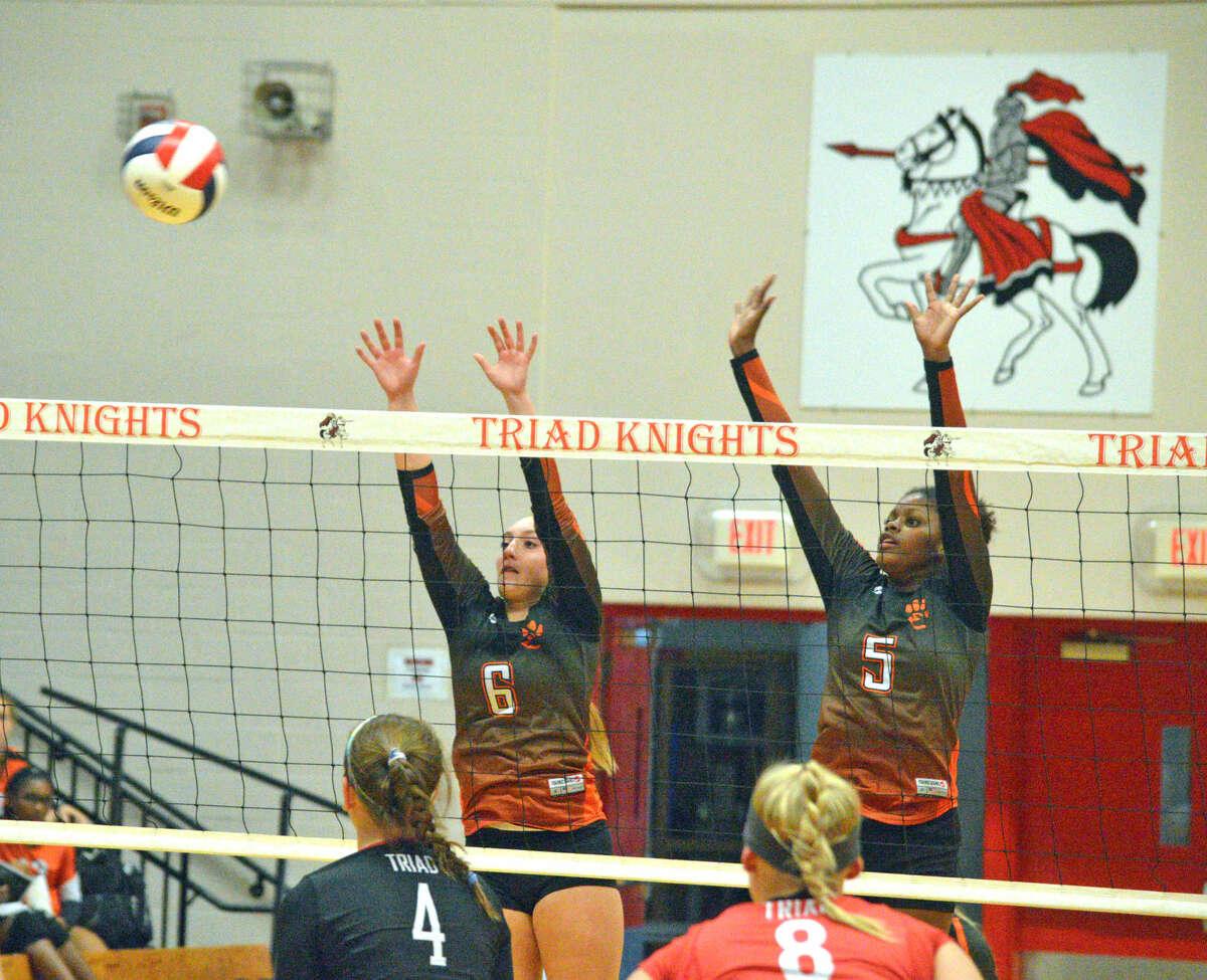 Edwardsville junior Rachel Verdun (No. 6) and freshman Kymel Bell go up for a block.