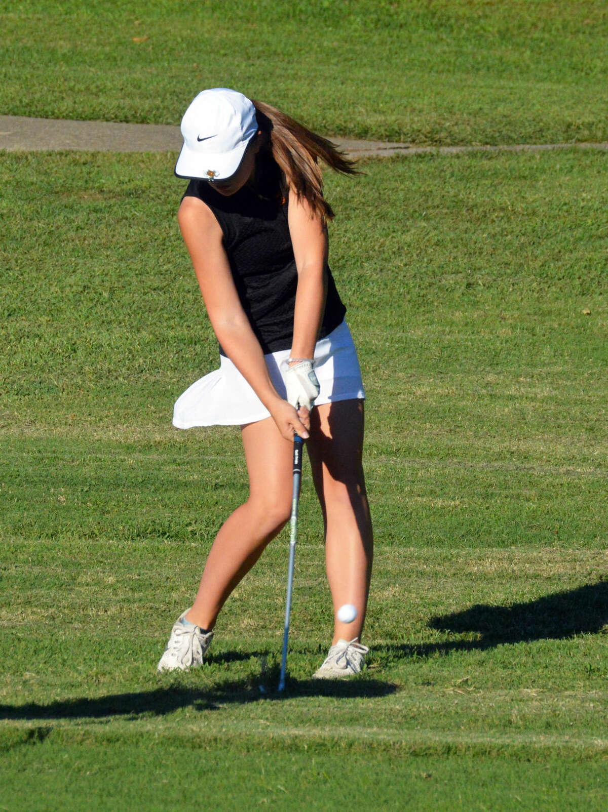 Edwardsville's Jessica Benson hits her second shot.