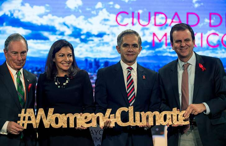 (L-R) The UN Special Envoy for Cities and Climate Change, Michael Bloomberg, Paris' Mayor Anne Hidalgo, Mexico City's Mayor Miguel Angel Mancera and Rio de Janeiro's Mayor Eduardo Paes pose for pictures during a conference in Mexico City on the second day of the C40 Mayors Summit on December 1, 2016. Mayors from scores of the world's biggest cities gather in Mexico to plot their strategy for fighting climate change in the face of skepticism from US President-elect Donald Trump. / AFP PHOTO / Hector GUERREROHECTOR GUERRERO/AFP/Getty Images