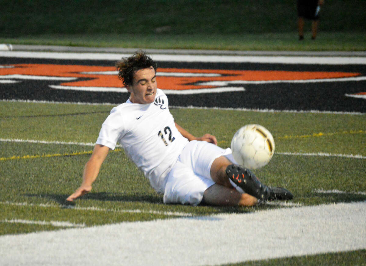 Edwardsville senior center back Matt Busse keeps a ball from going out of bounds midway through the first half in Tuesday's game against Collinsville at the District 7 Sports Complex.