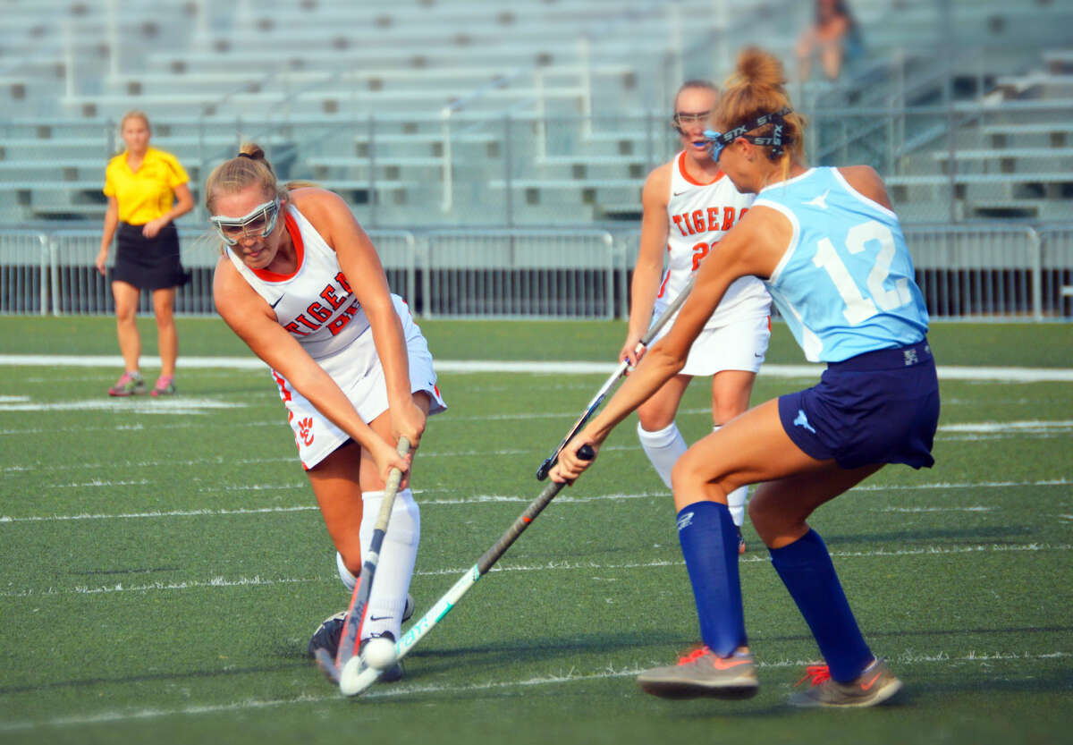 Edwardsville's Allie Hosto unleashes a shot from the top of the circle off of a short corner early in the first half against Parkway West.