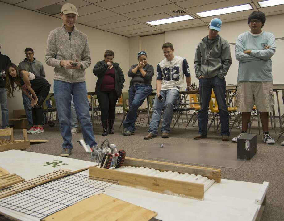 Alexis Borunda with Team Skillz That Killz, navigates their robot through the obstacle course Thursday 12-01-16 as part of the Introduction to Engineering class at Midland College. Tim Fischer/Reporter-Telegram Photo: Tim Fischer/Midland Reporter-Telegram