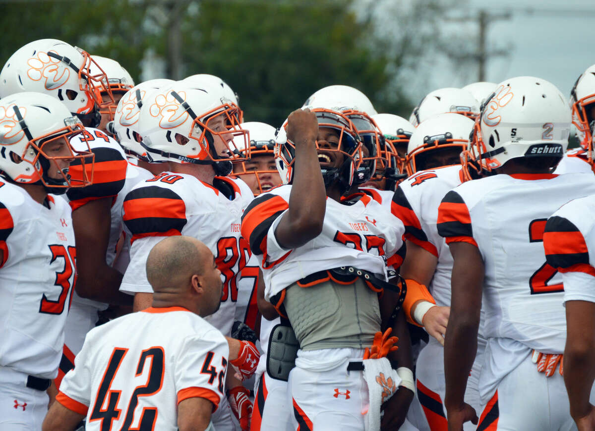 Edwardsville running back Dionte Rodgers, center, gets the Tigers fired up before Saturday's game against the Collinsville Kahoks.