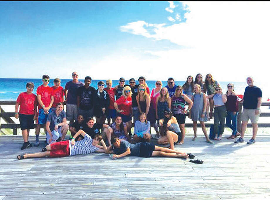 Members of First Christian Church's youth group gather at the beach in Panama City, Fla.