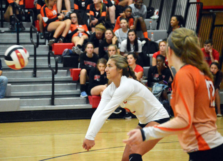 Edwardsville's Megan Woll successfully receives a serve during the second game.