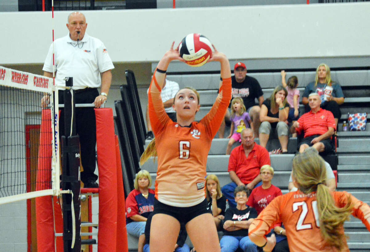 Edwardsville setter Rachel Verdun sets up a pass for Kate Martin in the second game at Granite City on Thursday.