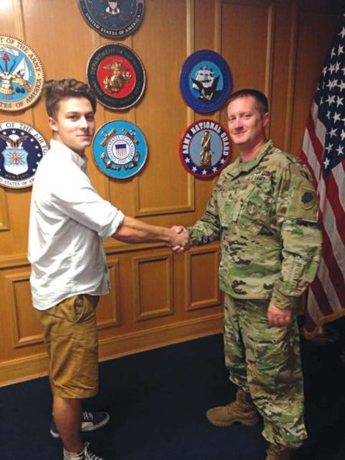Seth Davey, a senior at Edwardsville High School, shakes hands with Staff Sgt. Ty Lipe, a recruiter with Company M, Recruit Sustainment Program based in East St. Louis after Davey's enlistment ceremony in St. Louis. Davey will drill with Mike Co until he graduates and moves on to train as a human intelligence collector. Upon completion of basic training and his advanced individual training, Davey will be assigned to Headquarters and Headquarters Company, 634th Brigade Support Battalion based in Sullivan, Ill.