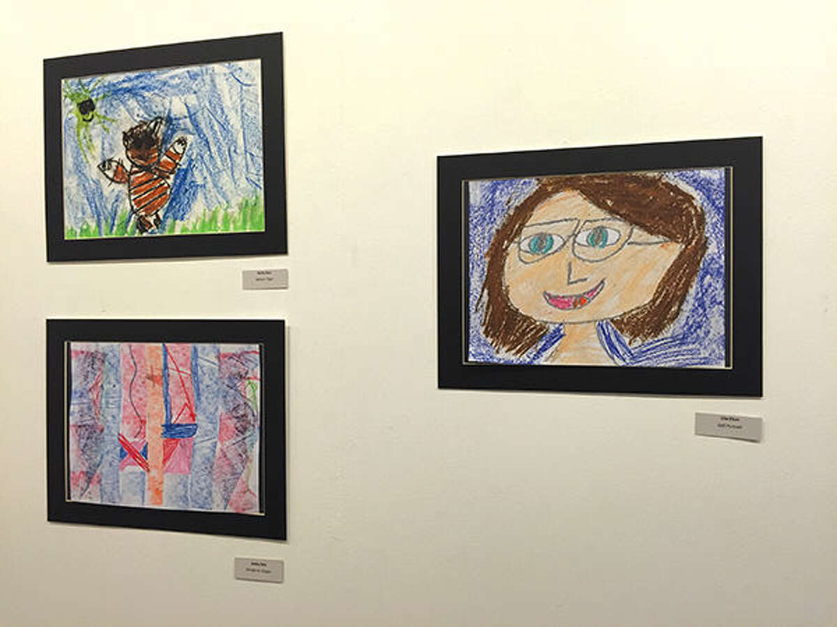 Three pieces of student art hanging in the Dennis DeToye Student Gallery at the EAC.