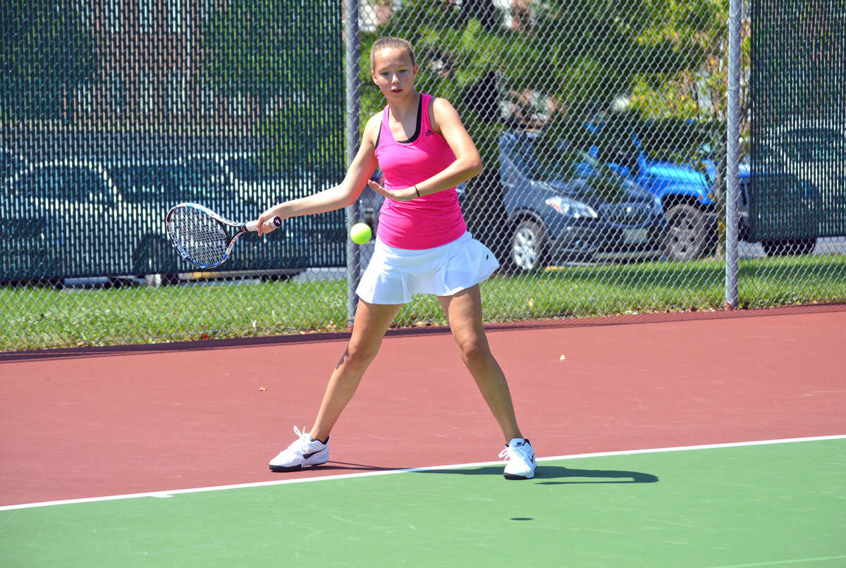 Morgan Marshall of Glen Carbon hits a forehand during her match in coed 14-and-under singles on Saturday at the STL-NET Edwardsville Junior Satellite tournament at the Edwardsville High School Tennis Center.