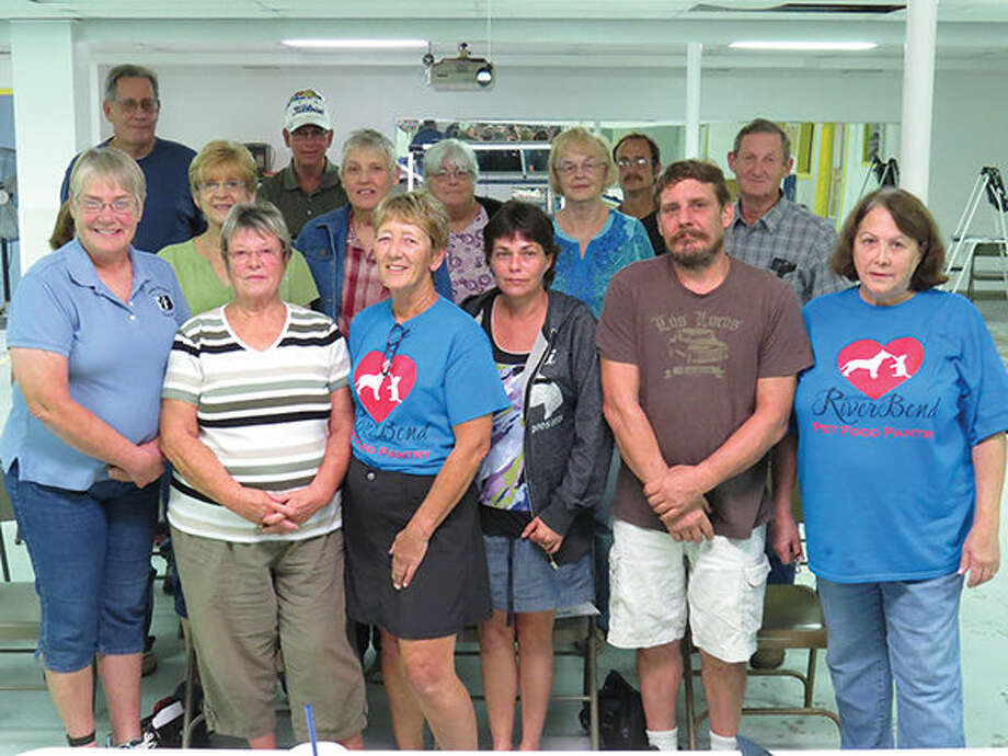 Member of the Edwardsville Illinois Kennel Club presented members of the River Bend Pet Food Pantry with a donation at their meeting last week.