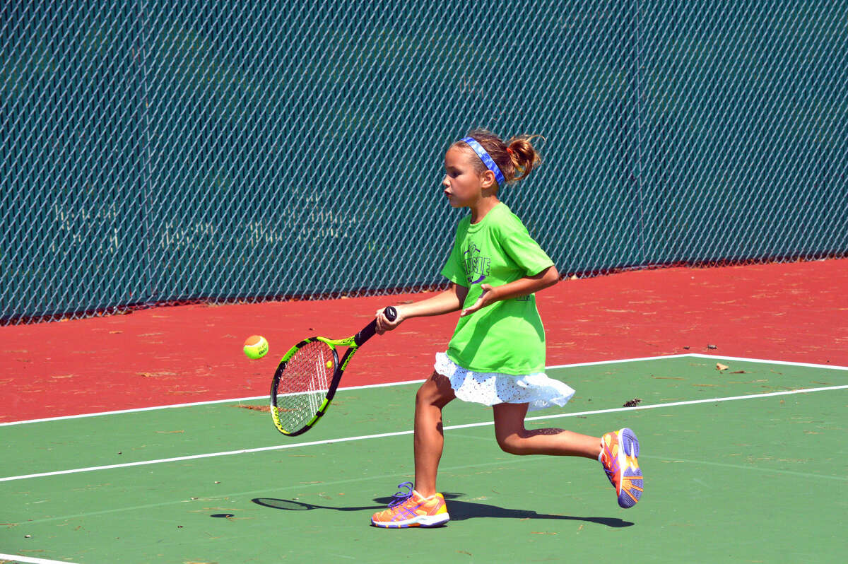 Katie Woods of Edwardsville makes a return during her match in the coed singles 10-and-under A Division.