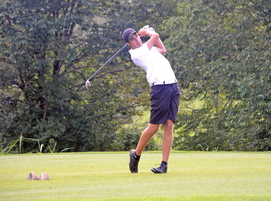 Edwardsville senior Spencer Patterson hits a tee shot on hole No. 17 on Tuesday during the Alton Tee-Off Classic at Spencer T. Olin Golf Course.