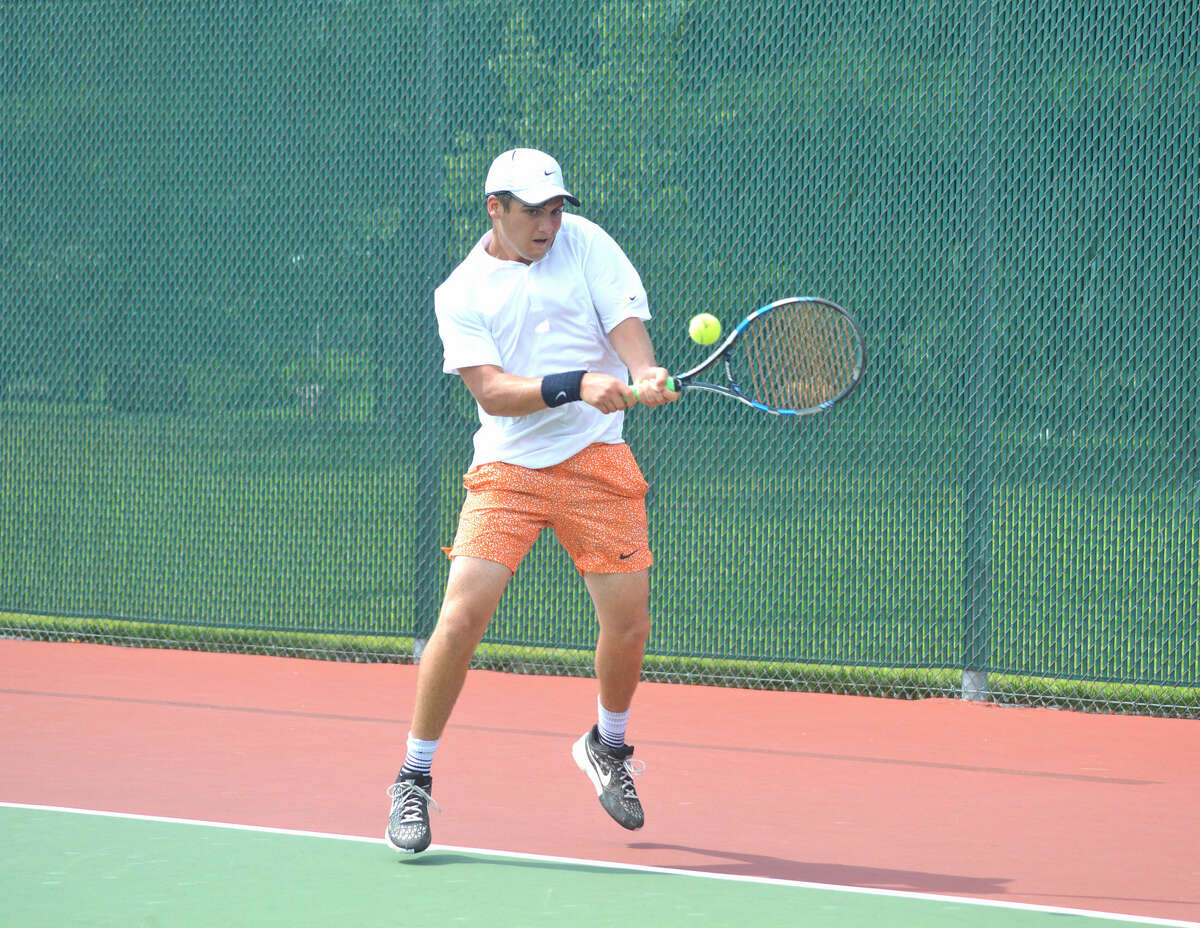Seth Lipe, who will be a sophomore at EHS, hits a backhand during his first-round consolation match.