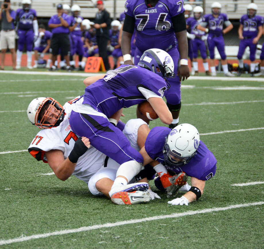 Edwardsville nose tackle Tate Rujawitz pulls down the Collinsville quarterback for one of his two sacks.