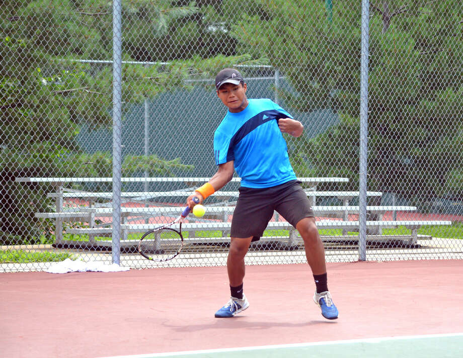 Zach Trimpe, who will be a sophomore at Edwardsville High School, makes a forehand return during his round of 16 consolation on Wednesday in the Pro Wild Card Challenge at the EHS Tennis Center.