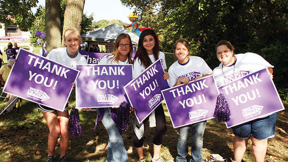 Participants in last year's Walk to End Alzheimer's hold signs of appreciation.