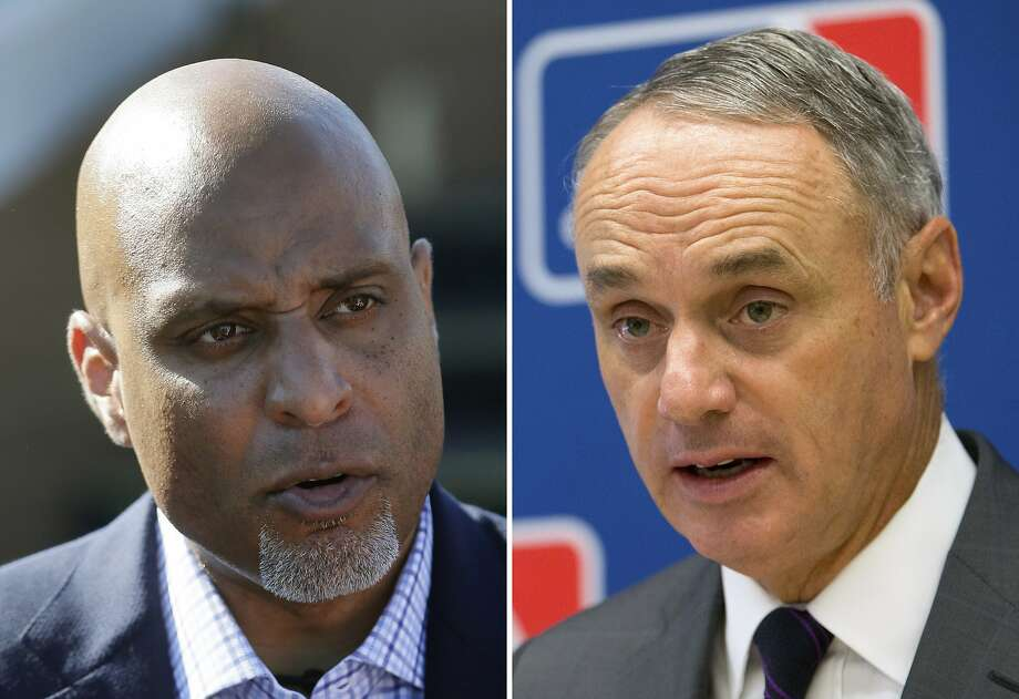FILE - At left, in a March 17, 2015, file photo, Major League Baseball Players Association executive and former Detroit Tigers first baseman Tony Clark talks to the media before a spring training exhibition baseball game in Lakeland, Fla. At right, in a May 19, 2016, file photo, Baseball Commissioner Rob Manfred speaks to reporters during a news conference at Major League Baseball headquarters in New York. Negotiators for baseball players and owners are meeting this week in Irving, Texas, in an attempt to reach agreement on a collective bargaining agreement to replace the five-year contract that expires Thursday, Dec. 1, 2016. (AP Photo/File) Photo: AP