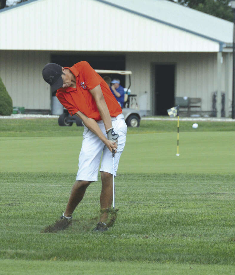 Edwardsville senior Spencer Patterson hits his second shot on Hole No. 6 at Belk Park Golf Course in Wood River.