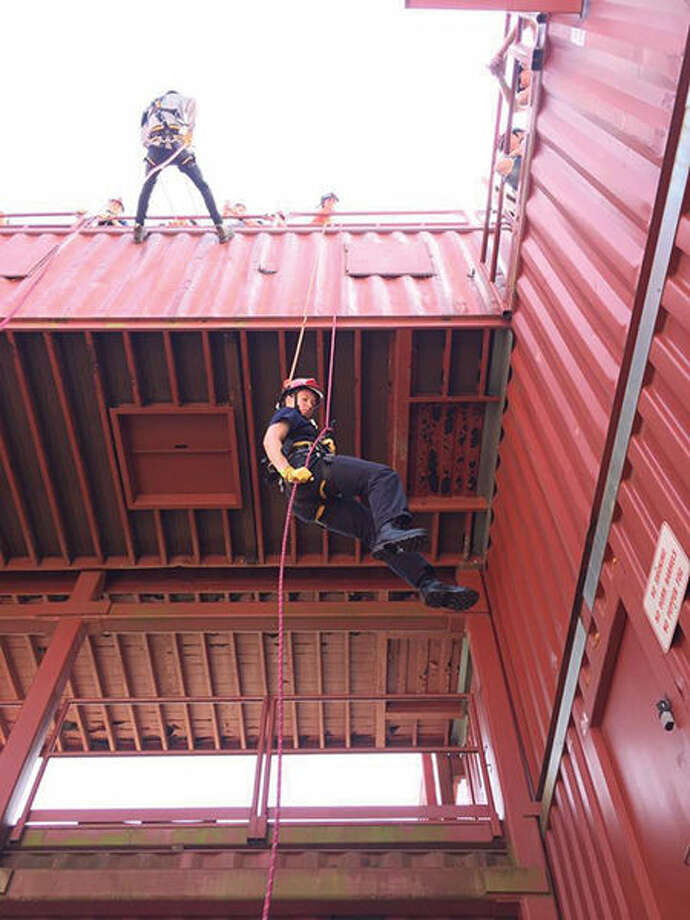 "Cadets rappel down a structure at 14th Annual Illinois Fire Service Institute's Explorer-Cadet ""Hands On Training Fire School."""