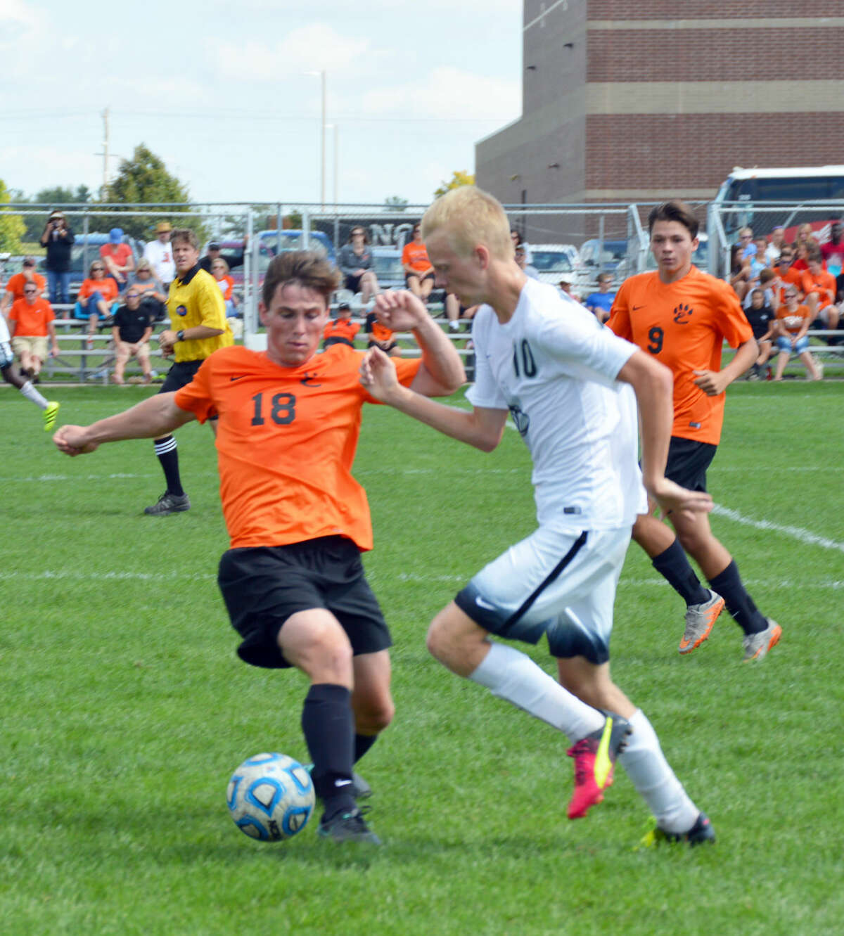 Edwardsville's John Wasmuth, left, tries to steal the ball near midfield.