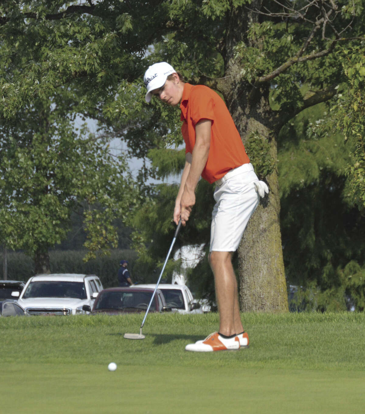 Edwardsville junior Tanner White watches his putt roll toward the hole on the No. 9 green.
