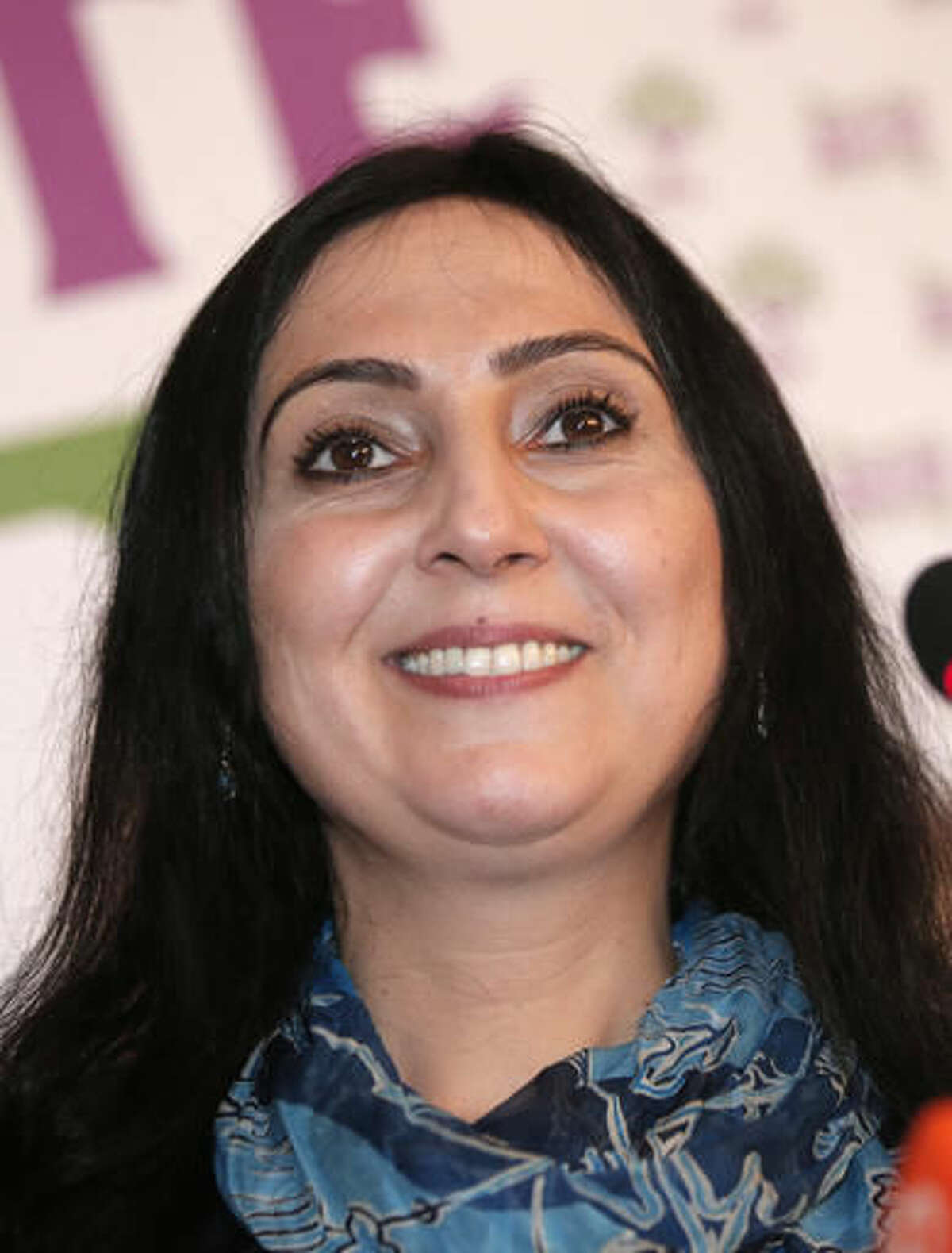 FILE- In this Sunday, June 7, 2015, file photo, Figen Yuksekdag, co-chair of the pro-Kurdish Peoples' Democratic Party, (HDP), smiles during a news conference in Istanbul regarding their party's success at the elections. Authorities in Turkey detained 11 pro-Kurdish lawmakers early Friday, Nov. 4, 2016, as part of ongoing terror-related investigations, including Demirtas, Yuksekdag and other senior officials, the Interior Ministry said. (AP Photo/Lefteris Pitarakis, File)