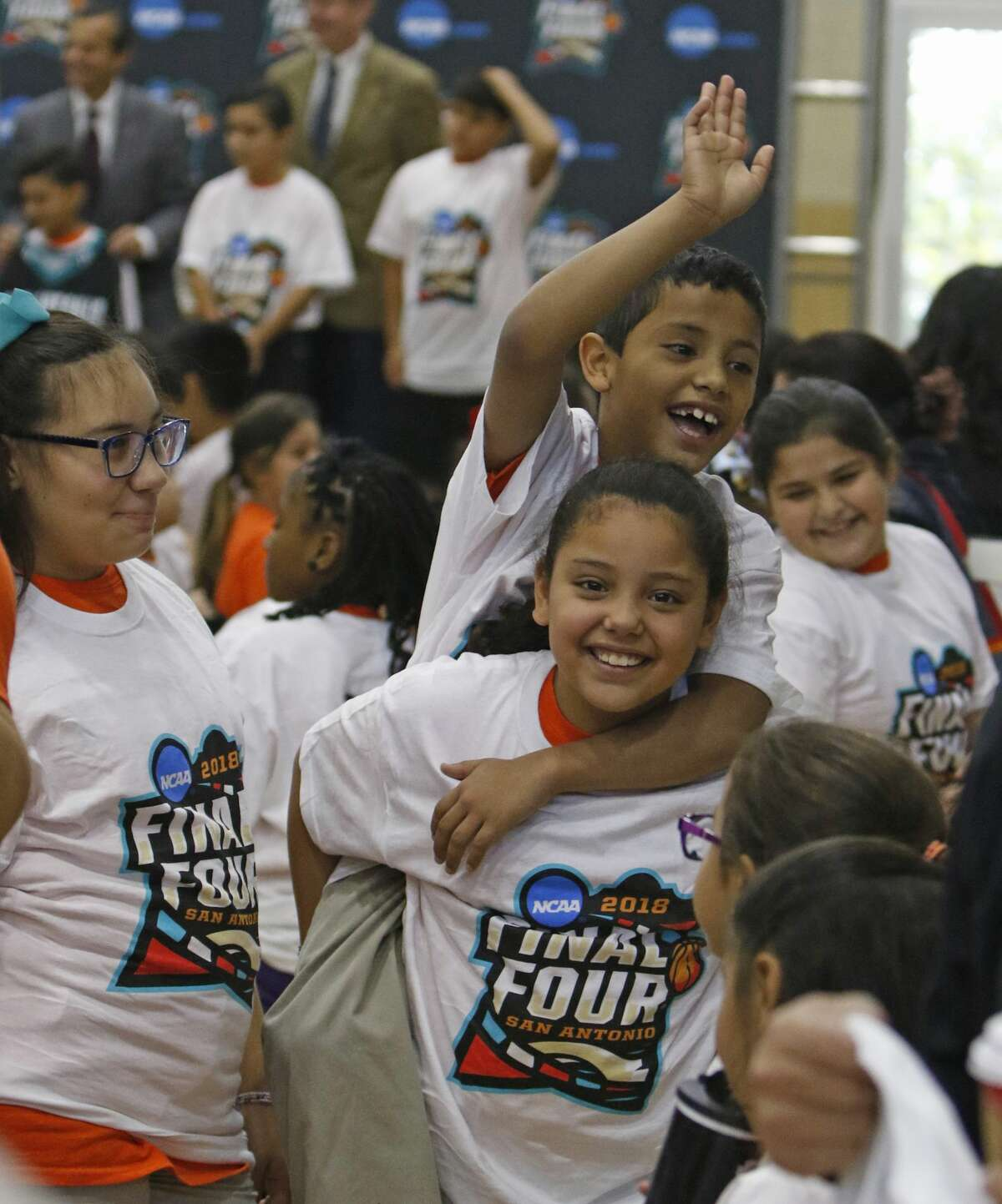 Elementary students from the San Antonio Sports i play after school program celebrate after being given t shirts with final four logo at the Final Four Logo Unveiling & Pep Rally Kick Off Road to San Antonio. The NCAA and San Antonio Local Organizing Committee (SALOC) will unveil the logo for the 2018 Men?•s Final Four¨ before 1,000 elementary students, dignitaries and special guests. The UTSA band and cheerleaders will also participate. The unveiling kicks off 18 months of preparation as San Antonio gets ready to host this premier sports event. Thursday, December 1, 2016 at Mission Conception Sports Gym.