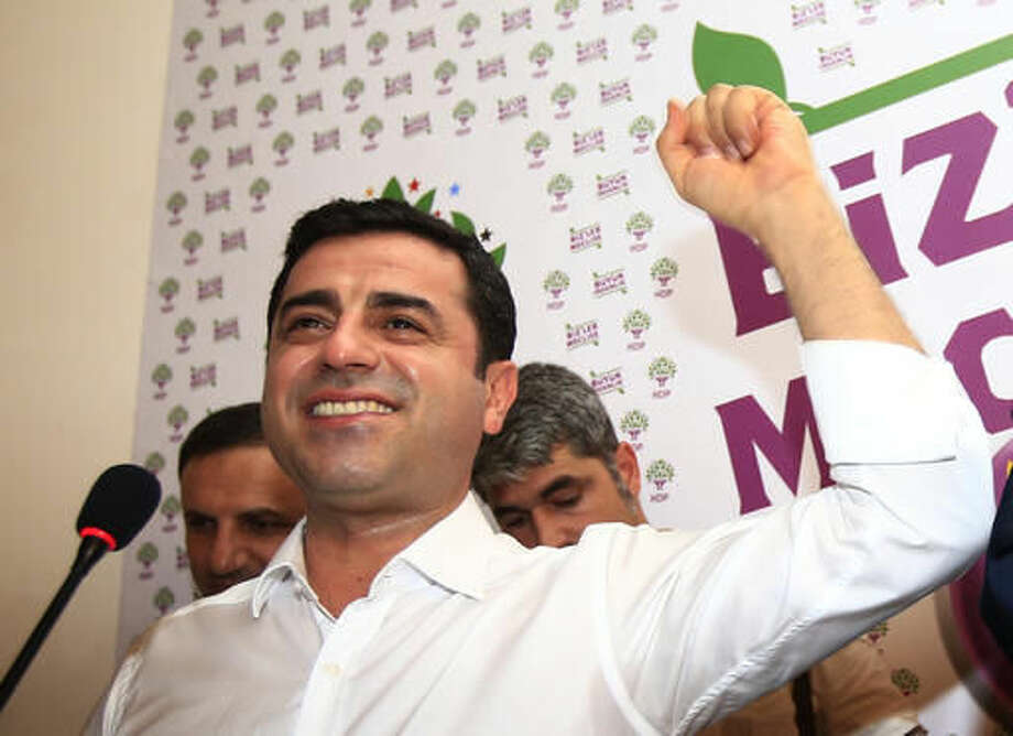 FILE-In this Sunday, June 7, 2015 file photo, Selahattin Demirtas, co-chair of the pro-Kurdish Peoples' Democratic Party, (HDP) celebrates following a news conference in Istanbul, regarding their party's success at the elections. Authorities in Turkey detained 11 pro-Kurdish lawmakers early Friday, Nov. 4, 2016 as part of ongoing terror-related investigations, including Demirtas, Yuksekdag and other senior officials, the Interior Ministry said. The government accuses the HDP of being the political arm of the outlawed Kurdistan Workers' Party, or PKK, which has fought an armed insurgency against the state for over three decades. The HDP rejects the accusation.(AP Photo/Lefteris Pitarakis, File)