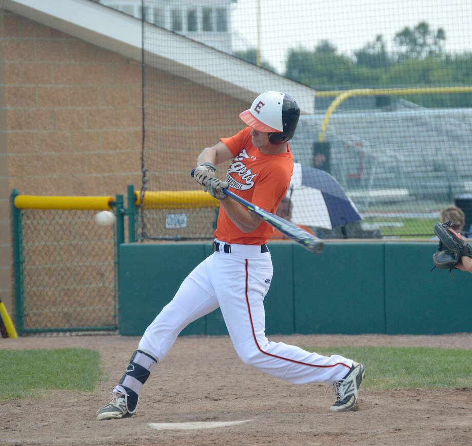 Edwardsville's Dylan Burris hits an RBI triple to left during the bottom of the first inning at Tom Pile Field.