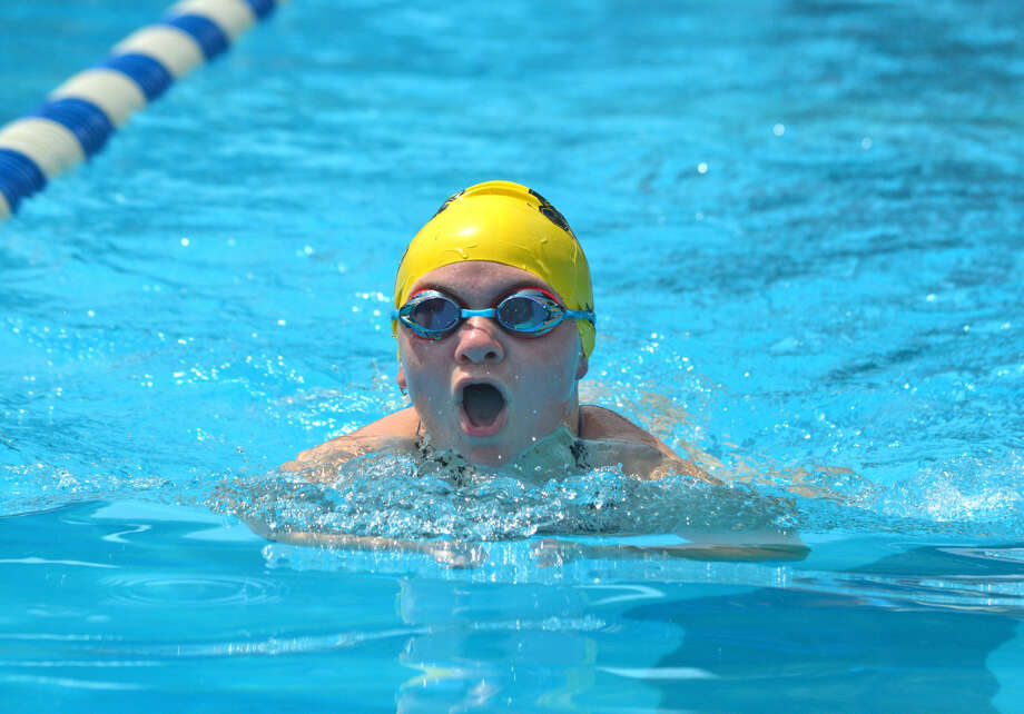 Reese Etcheson of Sunset Hills swims in the girls 11-12 100-yard IM.