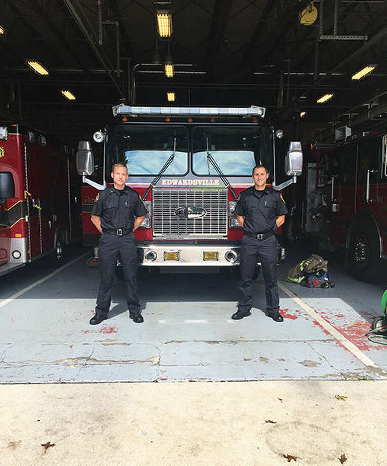 Colin Welsh (left) and Nick O'Dell (right) pose in front of a firetruck at the Edwardsville Fire Station. Recently hired as new firemen for the upcoming SIUE fire station, O'Dell and Welsh have already started their new positions and training.