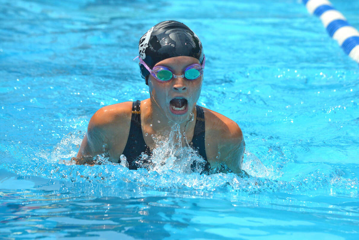 Isabella Grinter of Water Works swims in the 11-12 girls 100-yard IM during Sunday's SWISA Championship at Summers-Port in Godfrey.