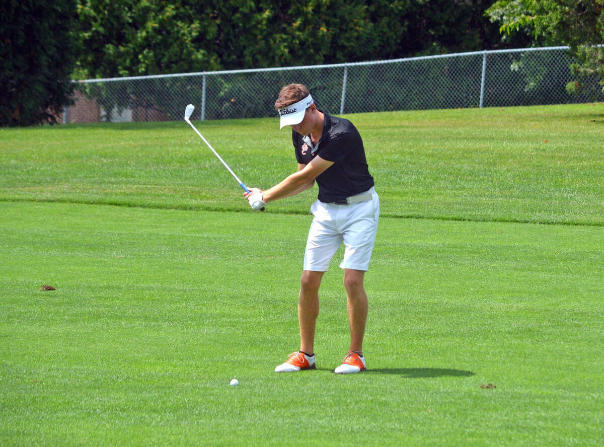 Edwardsville senior Luke Babington hits his third shot on hole No. 3 during the Quincy Invitational on Saturday at Westview Golf Course.