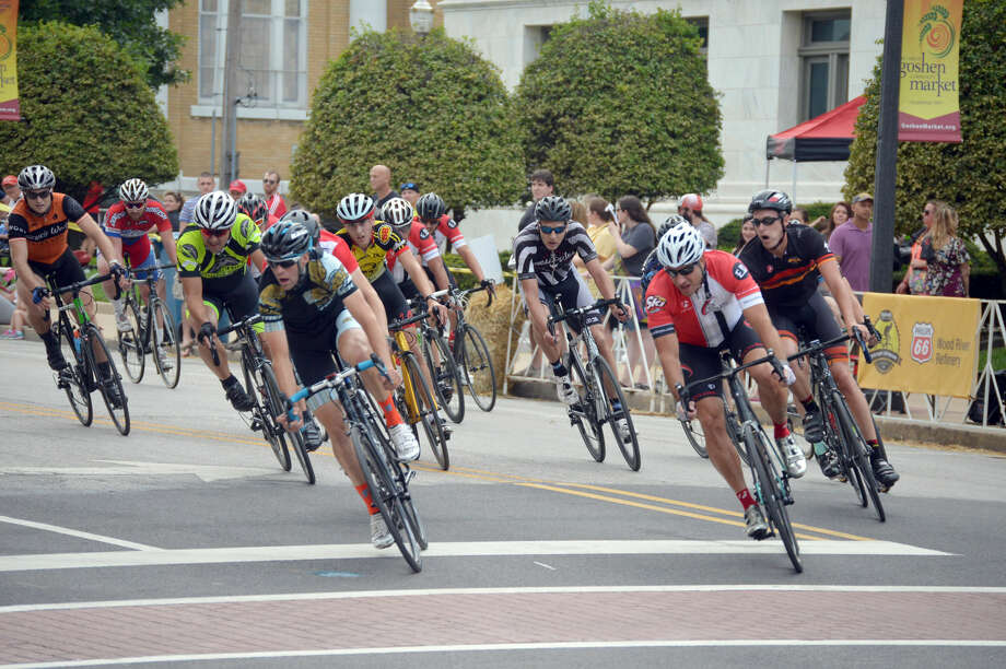 Cyclists make the final turn from St. Louis Street on to North Main Street during the final lap of the Cat 4 race during the Edwardsville Criterium.