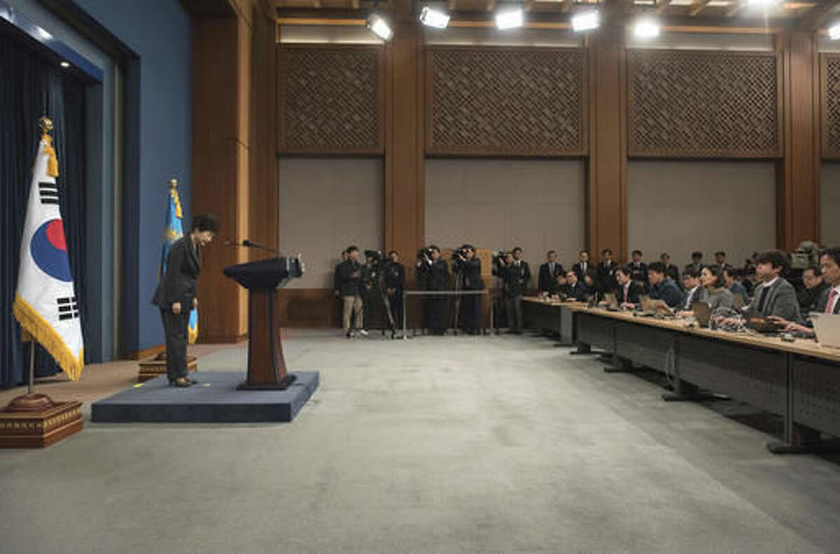 South Korean President Park Geun-hye bows before addressing the nation at the presidential Blue House in Seoul Friday, Nov. 4, 2016. Park took sole blame Friday for a