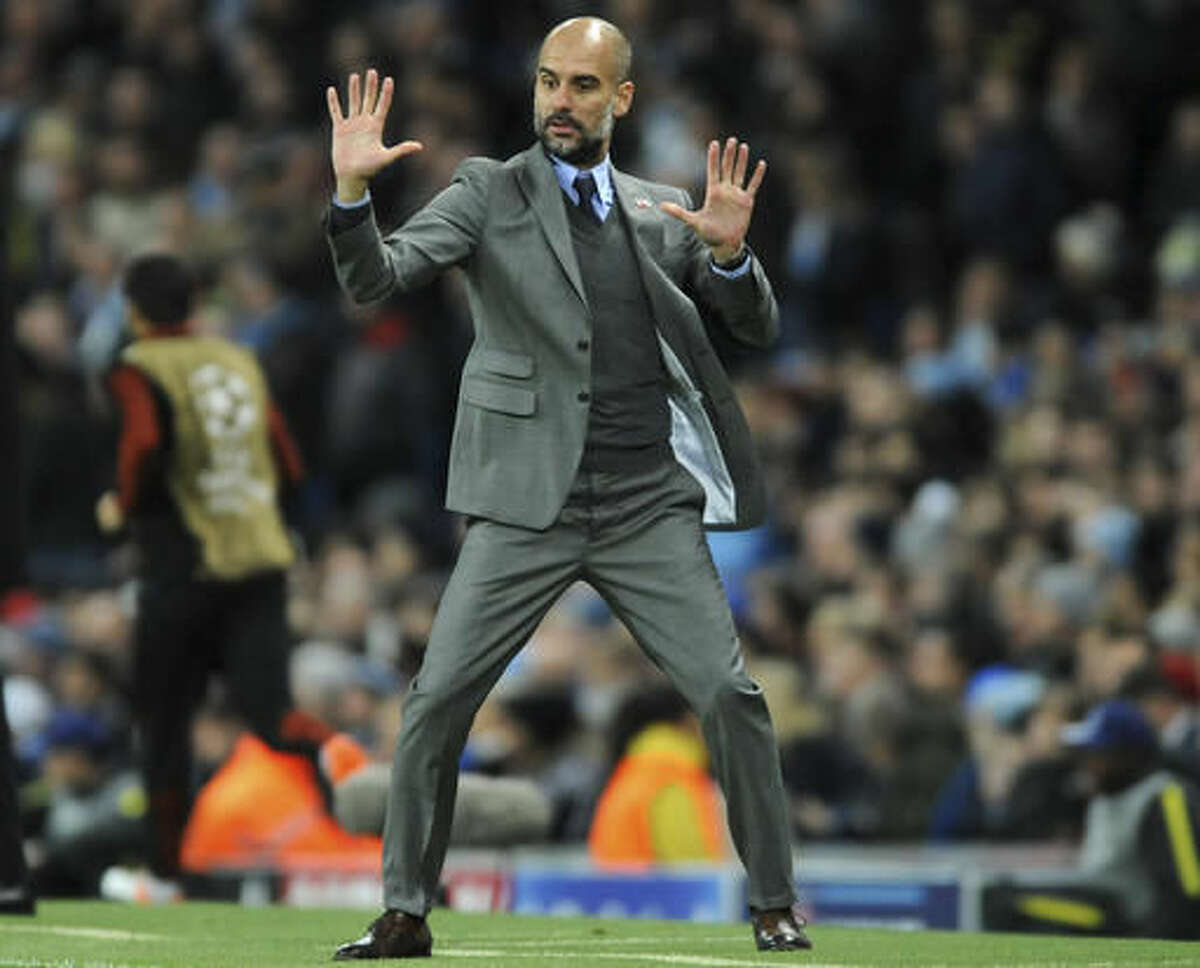 Manchester City's manager Pep Guardiola gestures during the Champions League group C soccer match between Manchester City and Barcelona at the Etihad stadium in Manchester, England, Tuesday, Nov. 1, 2016. (AP Photo/Rui Vieira)