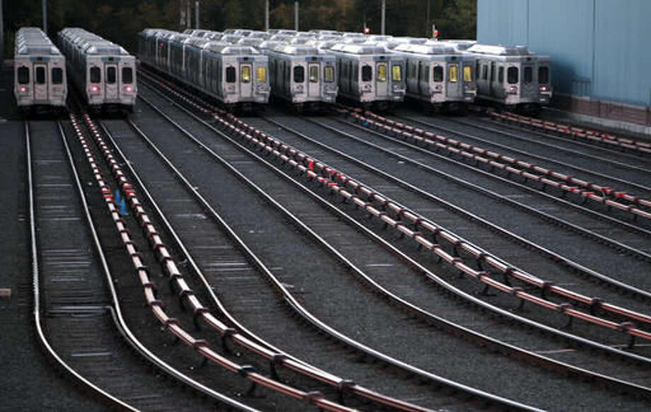 Market-Frankford line trains remain idle at a Southeastern Pennsylvania Transportation Authority (SEPTA) station Tuesday, Nov. 1, 2016 in Upper Darby, Pa., just outside Philadelphia. Commuters scrambled Tuesday to find alternate ways to travel as transit workers in Philadelphia and around hit the picket lines after the city's main transit agency and a union representing about 4,700 workers failed to reach a contract agreement. The union went on strike at 12:01 a.m. Tuesday, shutting down Southeastern Pennsylvania Transportation Authority buses, trolleys and subways that provide about 900,000 rides a day. (AP Photo/Jacqueline Larma)