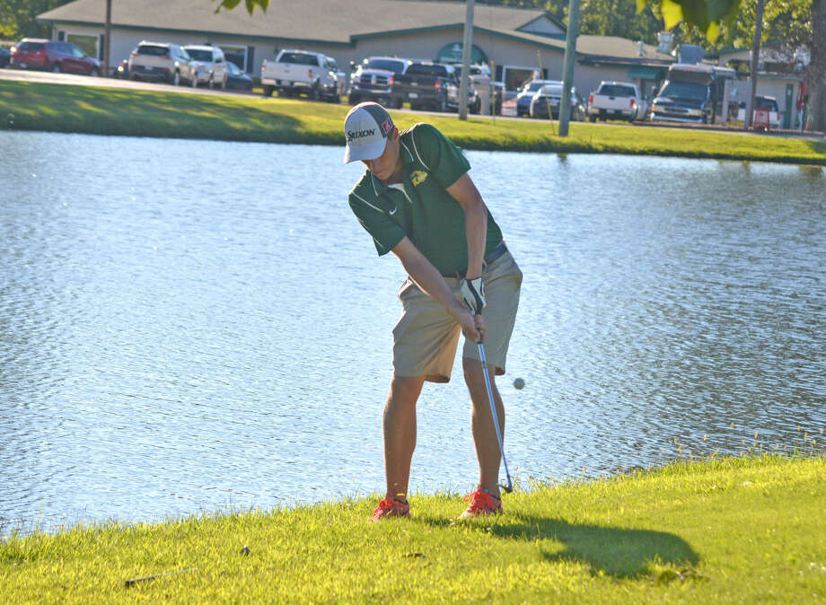 Metro-East Lutheran senior Braden Woolsey hits a chip shot on hole No. 9 at Timber Lakes Golf Course during Monday's dual match against Staunton.
