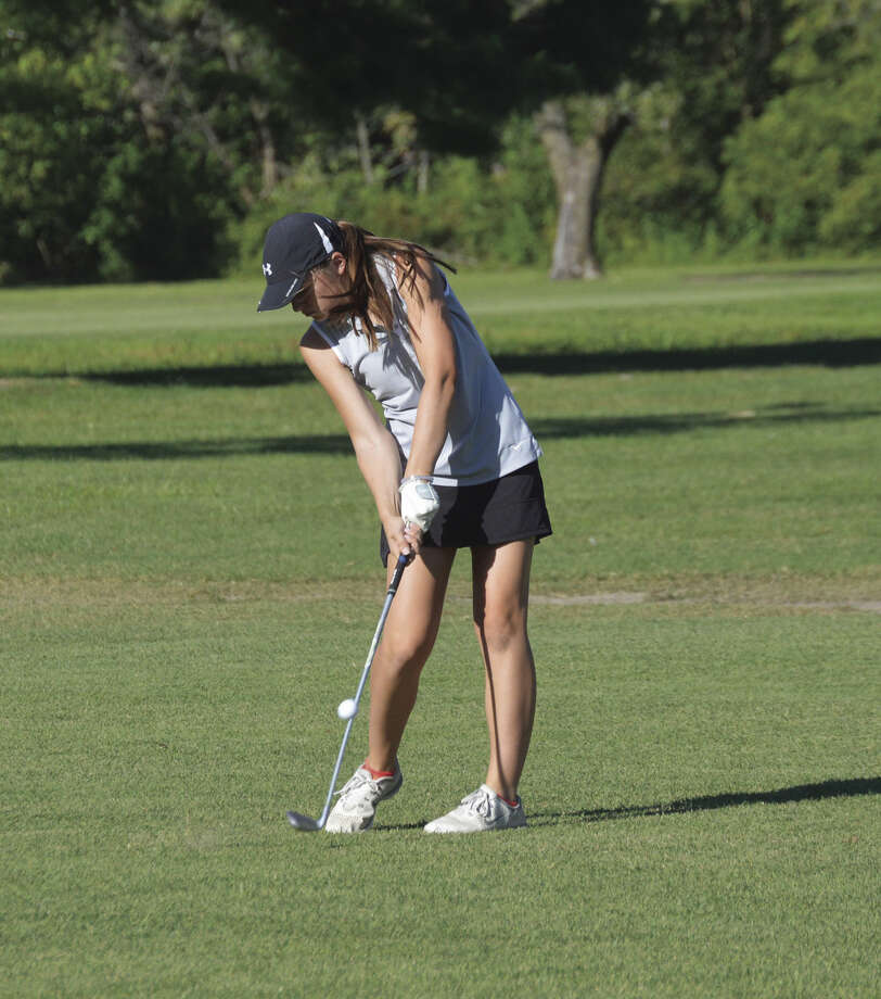 EHS freshman Jessica Benson hits her second shot on the seventh hole.