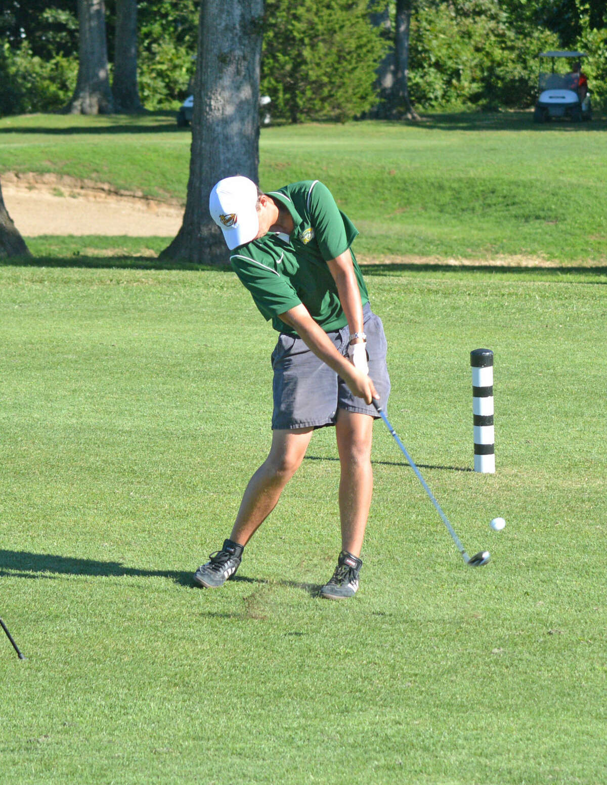 Metro-East Lutheran senior Mike Coulson hits his second shot on hole No. 5at Timber Lakes Golf Course during Monday's dual match against Staunton.