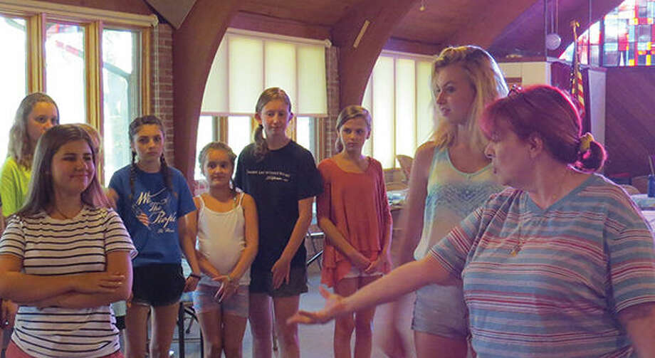 Director Liz Enloe works with some of the cast of Peter Pan. The Goshen Theatre Project will present the musical on August 4, 5 and 6 at the Hettenhaus Center for the Arts at McKendree University.