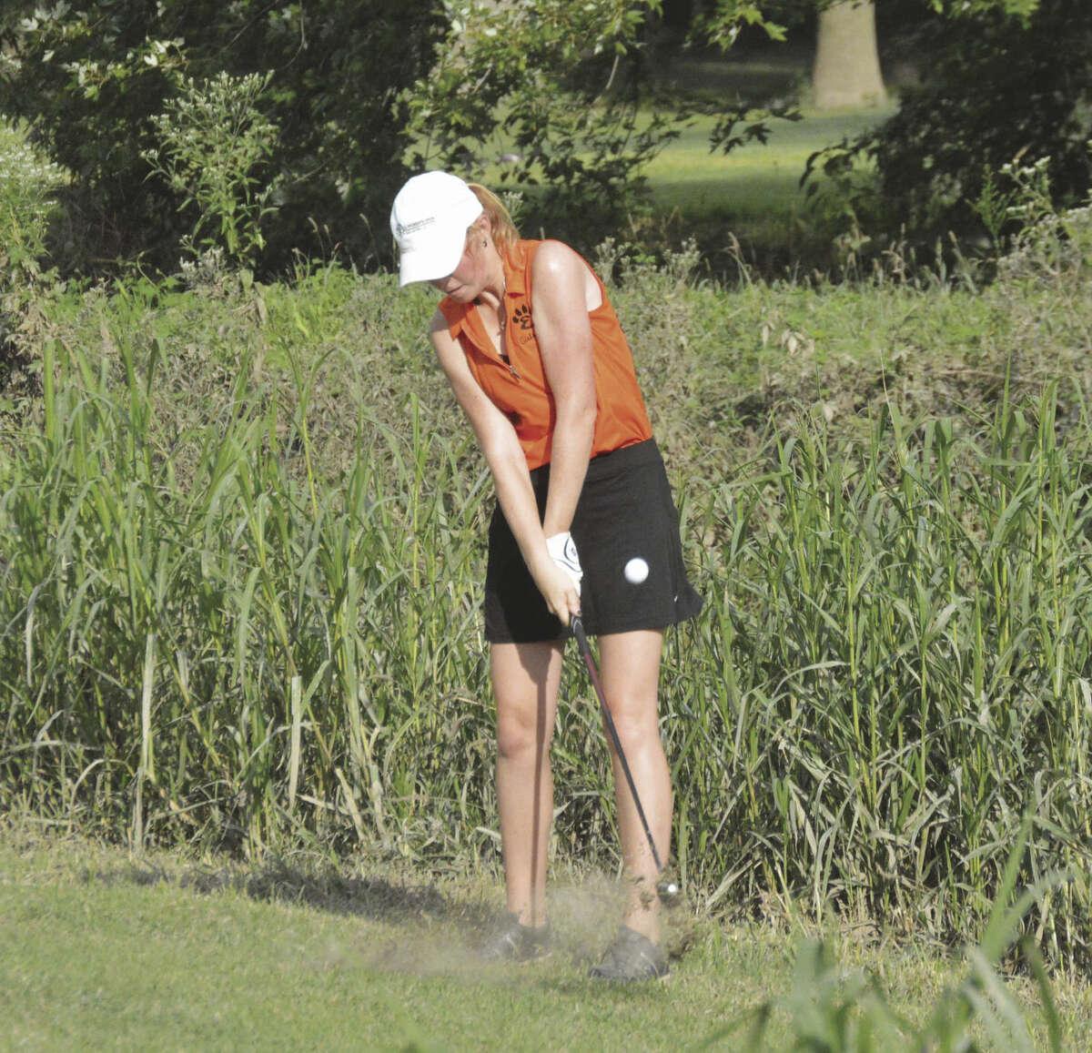 Edwardsville senior Kayla Weinacht hits an iron shot on the sixth hole of the east nine at Oak Brook Golf Club.