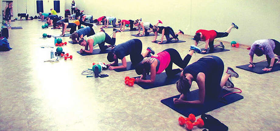 Participants work out during one of the Edwardsville YMCA's drop-in fitness classes.