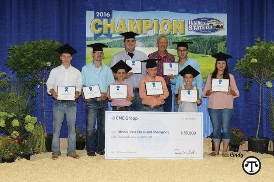 Grand champion and CME Group scholarship winners pictured here at the Illinois State Fair with Illinois Governor Bruce Rauner. (NAPS)